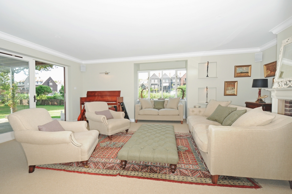 Sitting Room leading onto the garden with fire, dual aspect bay window and new soft furnishings